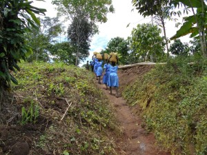 Mawanda village and their kids fetching water for the school