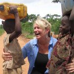 Jenny Parker with children returning with fresh water from Jesse's Well